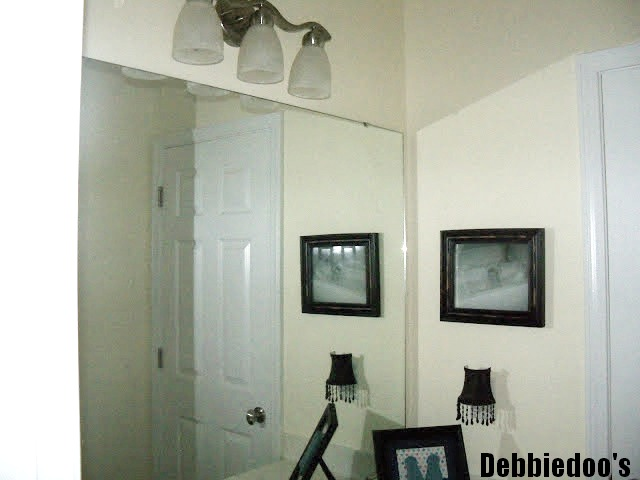 How to add molding around your bathroom builder grade for Molding around mirror bathroom