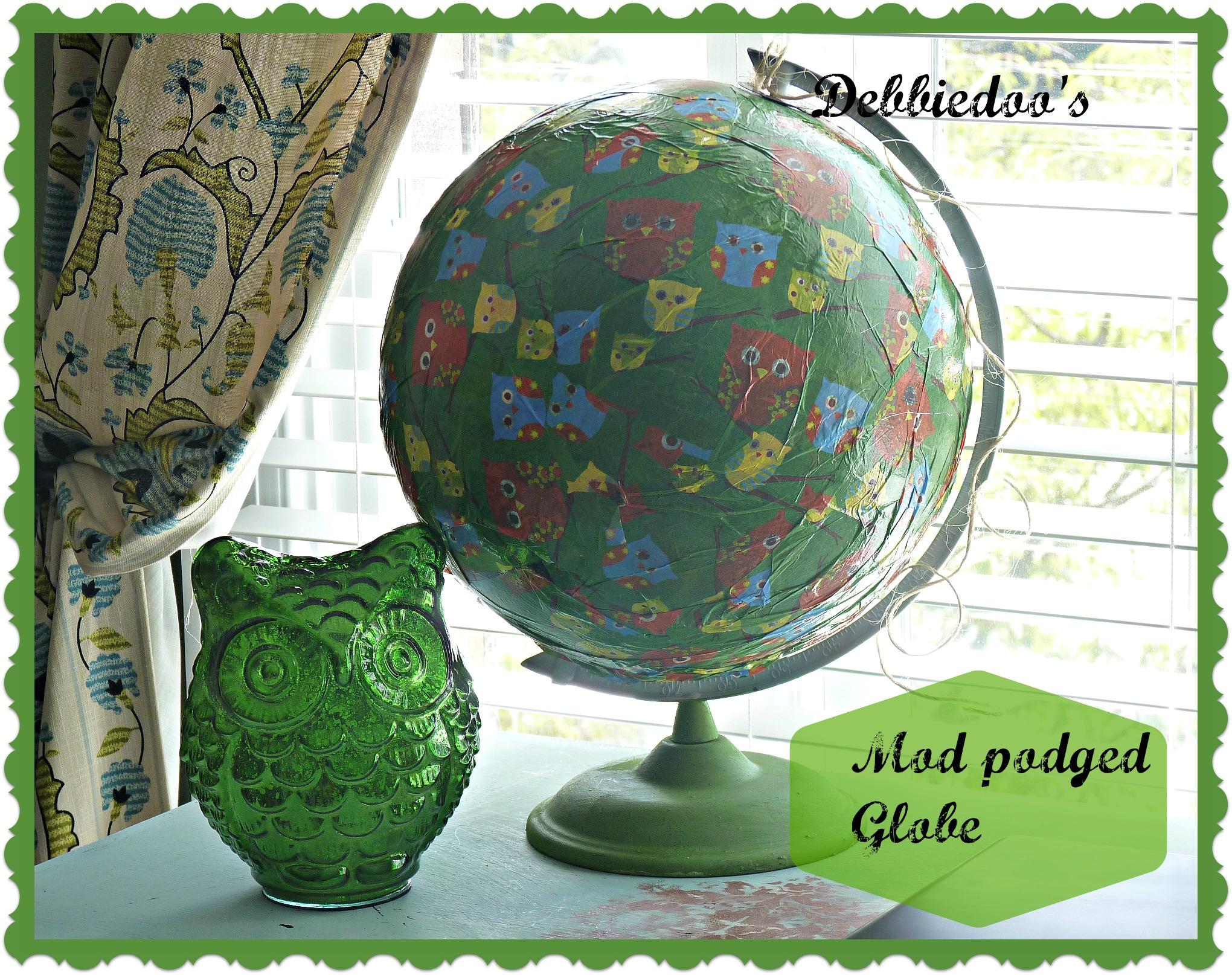 Mod podge on a globe