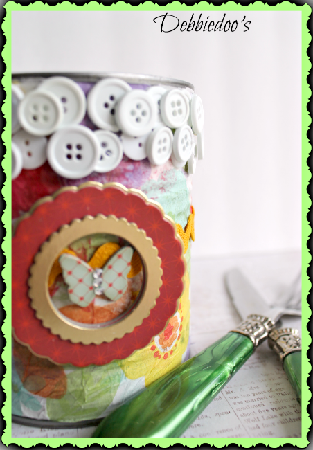 mod podge on a can and embellish with buttons