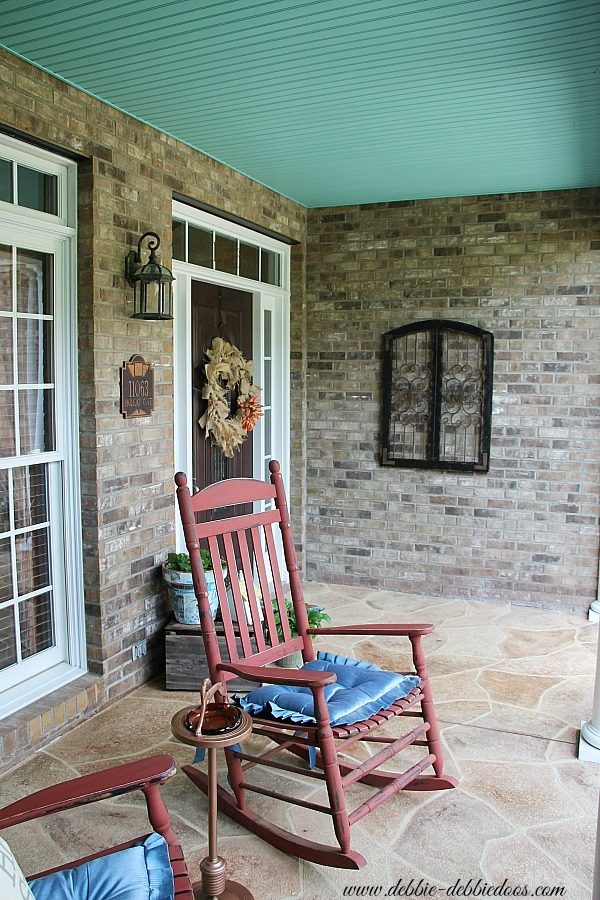 Rustic southern porch with haint blue ceiling