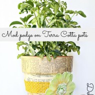 Mod podge terra cotta pots with fabric and a vintage recipe book 006