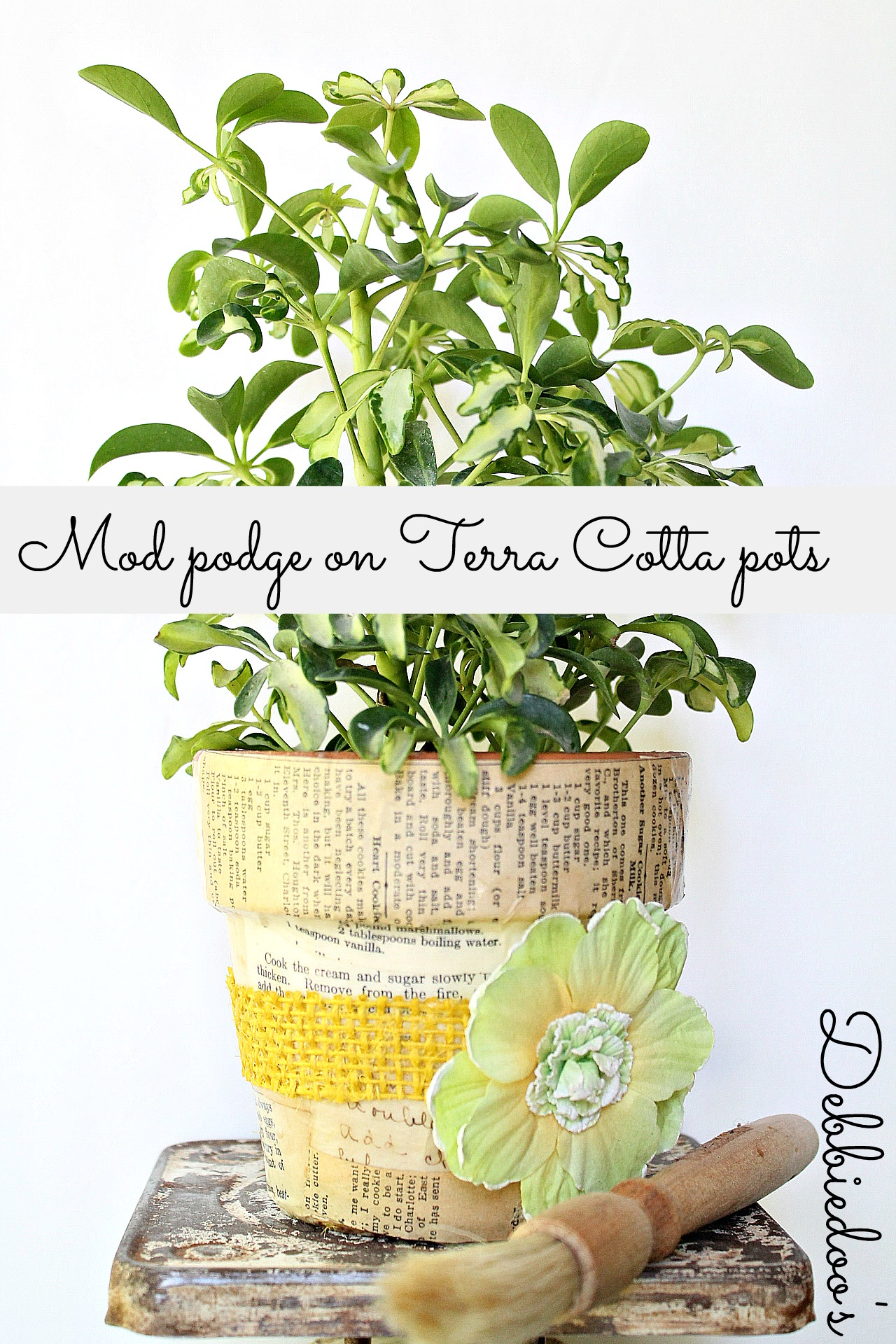 Mod podge terra cotta pots with fabric and a vintage recipe book