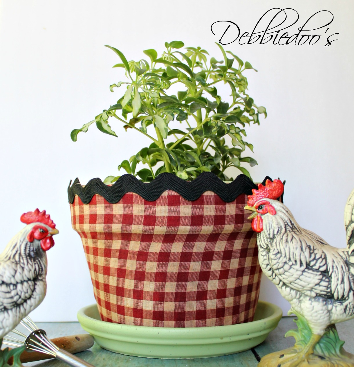 Mod podge terra cotta pots with fabric and a vintage recipe book 021
