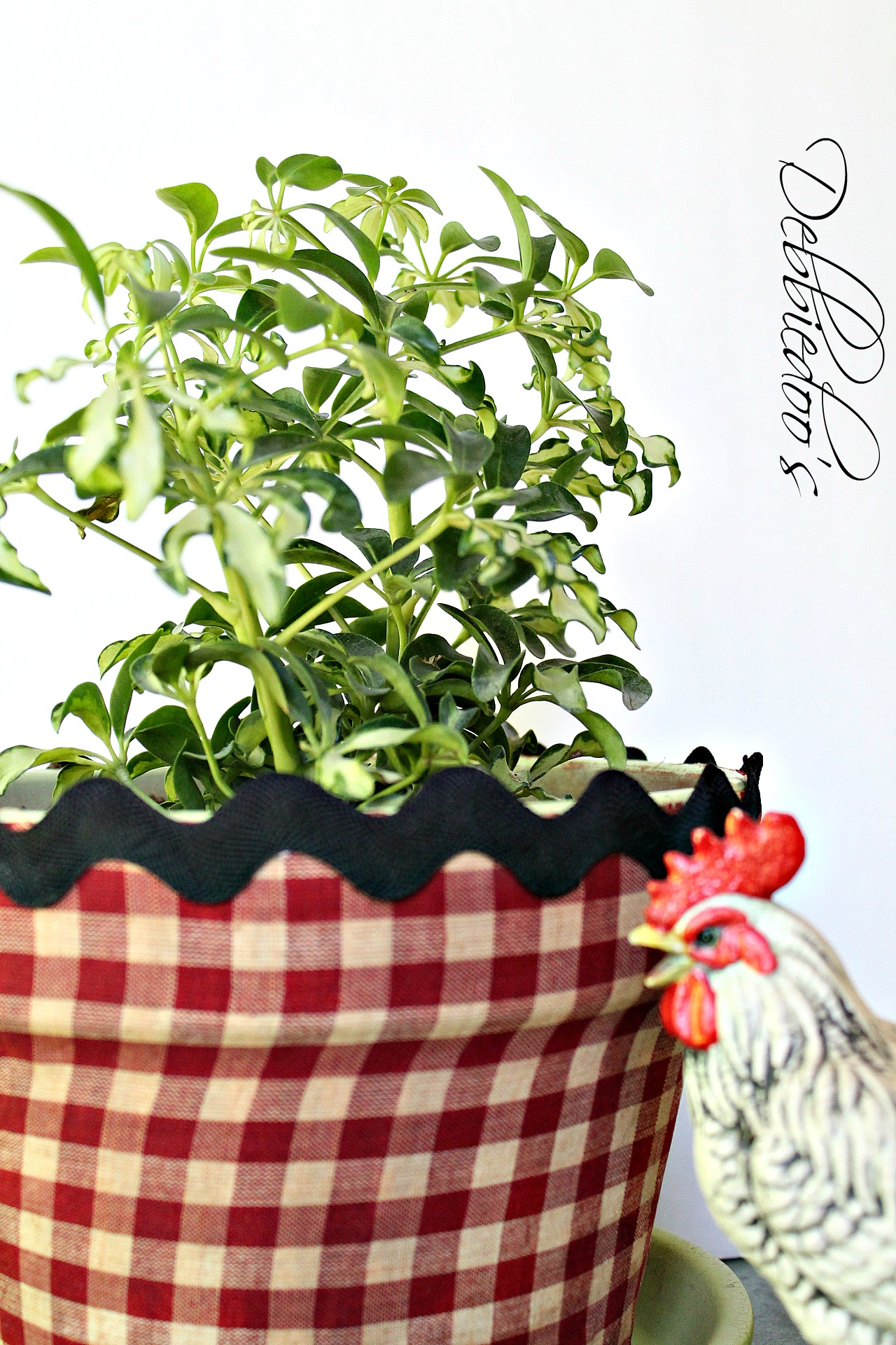 Mod podge terra cotta pots with fabric and a vintage recipe book 022