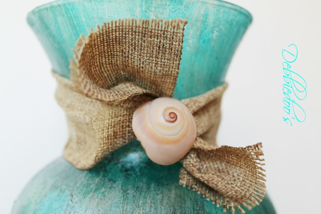 Coastal rit dye vase close up with sea shell