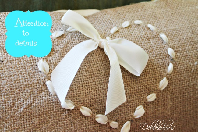 burlap chair wreath, pillow and runner in the kitchen with attention to details