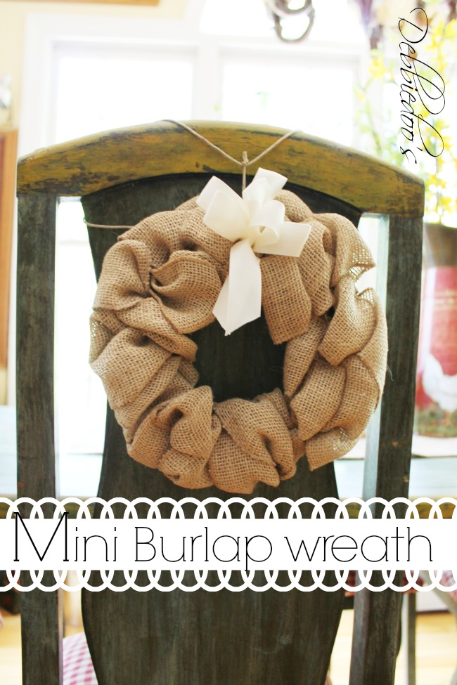 burlap chair wreath, pillow and runner in the kitchen