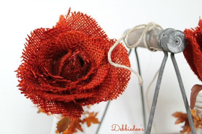 Dipping burlap roses in tangerine rit dye
