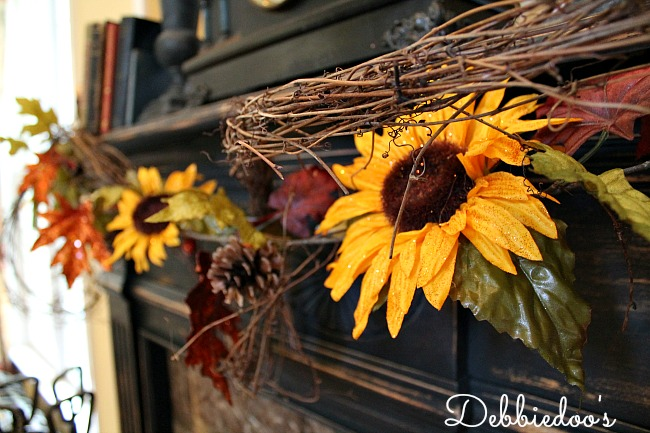 Fall mantel with sunflowers and rustic decor