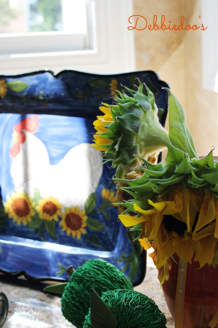 Sunflowers and roosters platter and flowers vignette