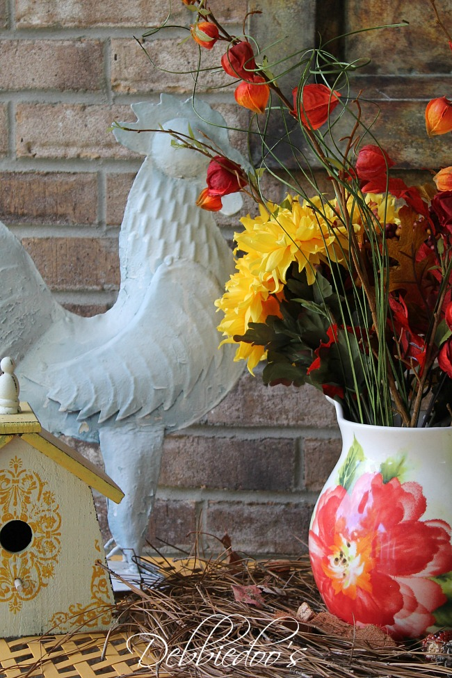 Fall porch rooster and flower vignette