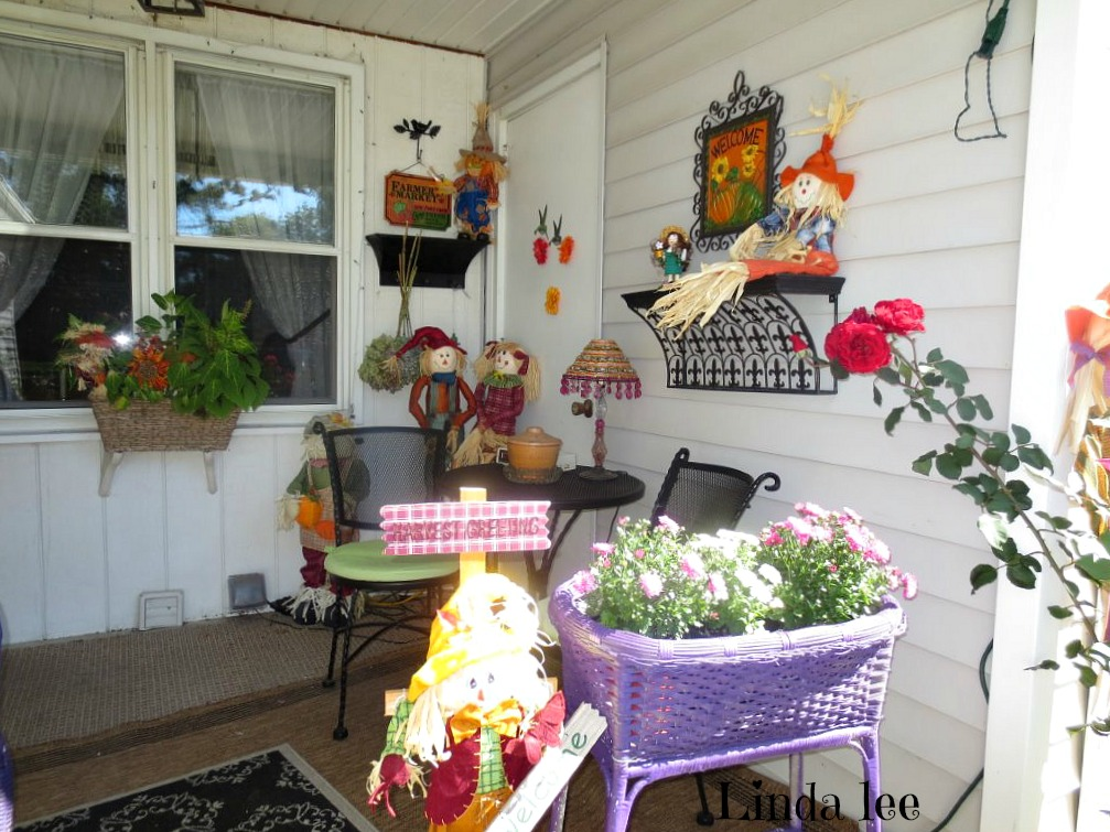 townhouse fall porch with scarecrows