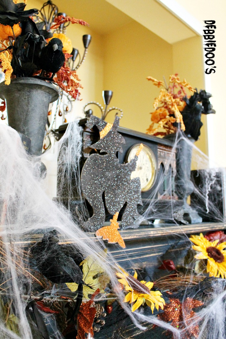 Halloween mantel with crows sunflowers and witches