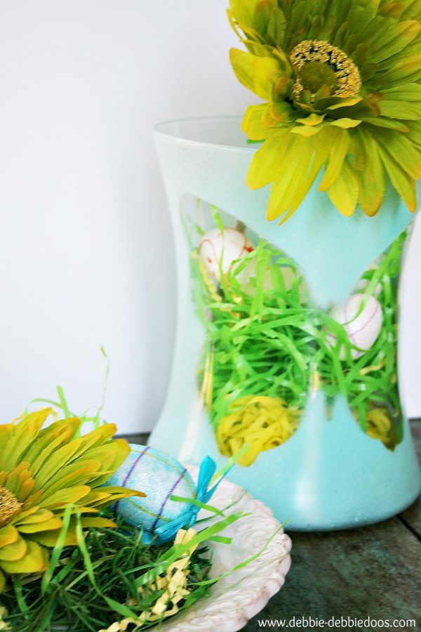 Dollar tree spray painted vase with foam butterfly silhouette