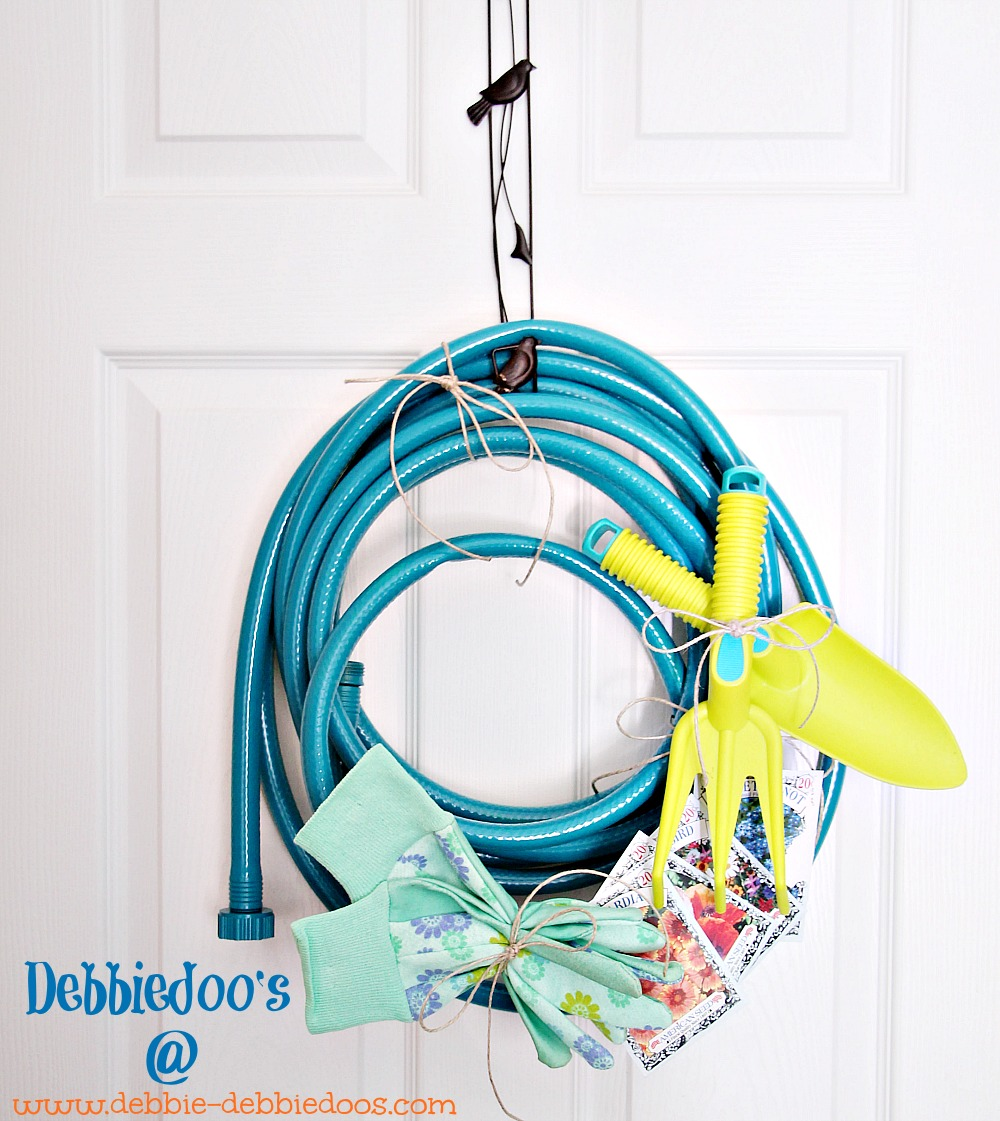 Garden hose turned garden spring wreath