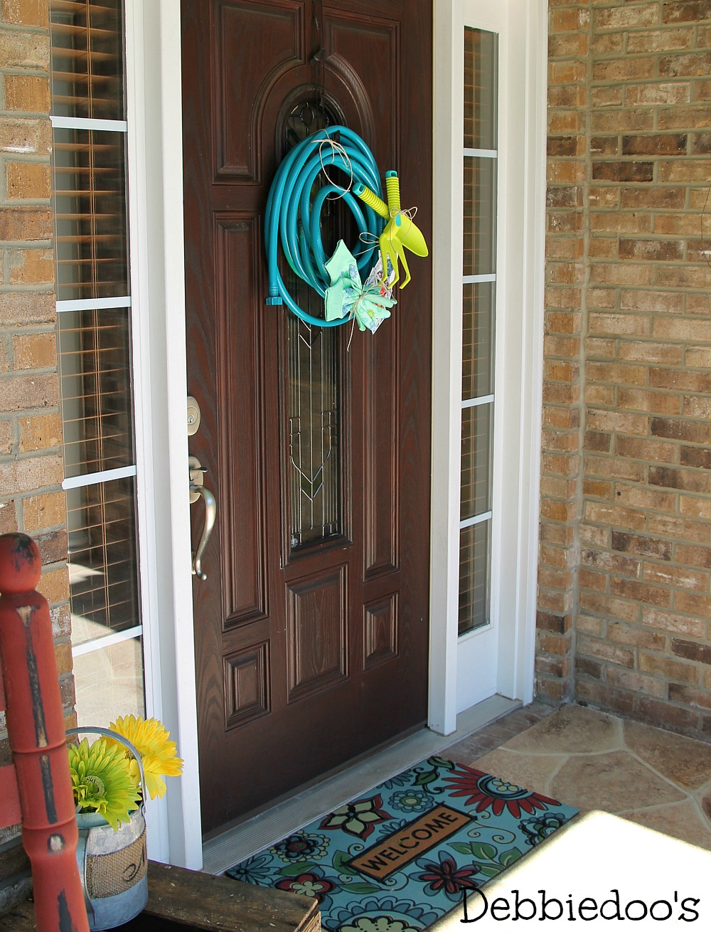 Welcome garden hose wreath