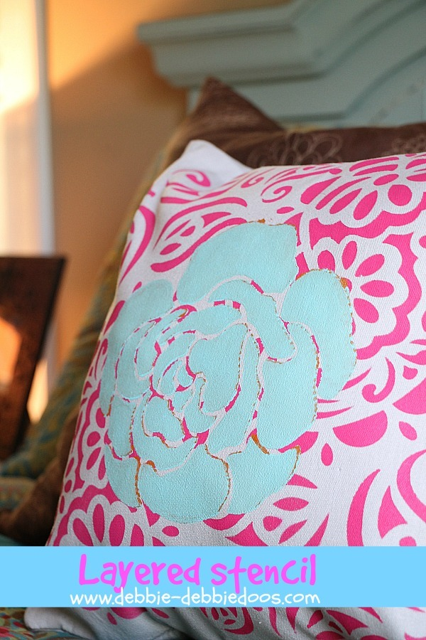 layered stenciled pillow with tulip