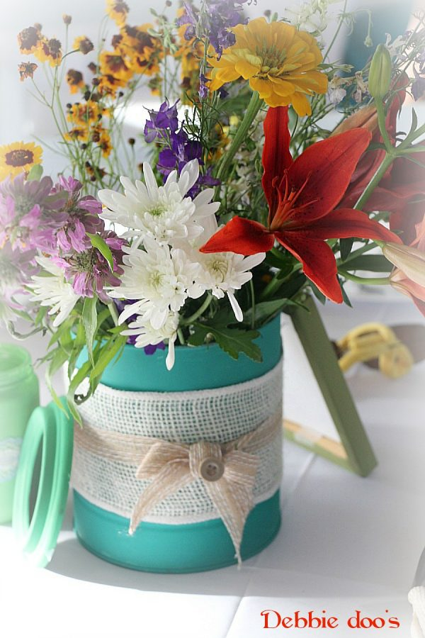 cans painted with chalky paint for garden wedding centerpieces