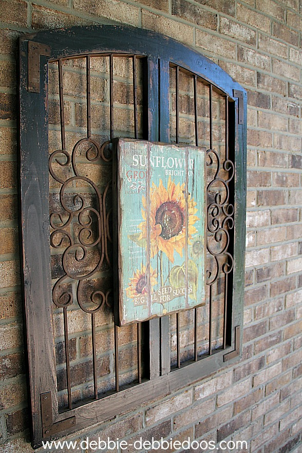 Sunflower picture on iron rustic gate
