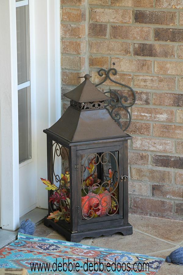 lantern filled with fall foliage