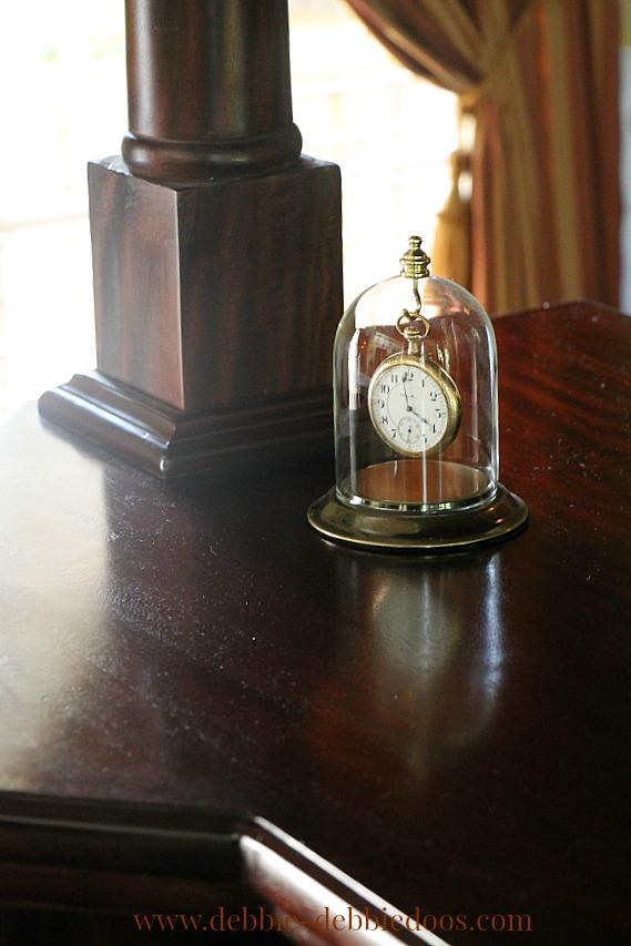 vintage pocket watch under glass dome cloche