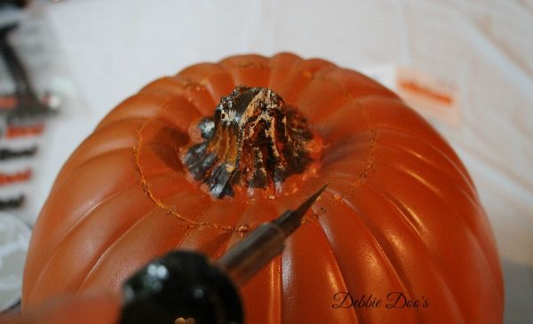 Carving a pumpkin with a hot knife