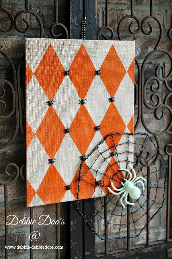 Harlequin Halloween art with dollar tree embellishments