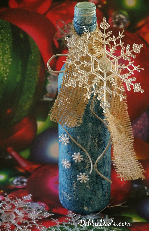 Christmas embellished and painted wine bottle