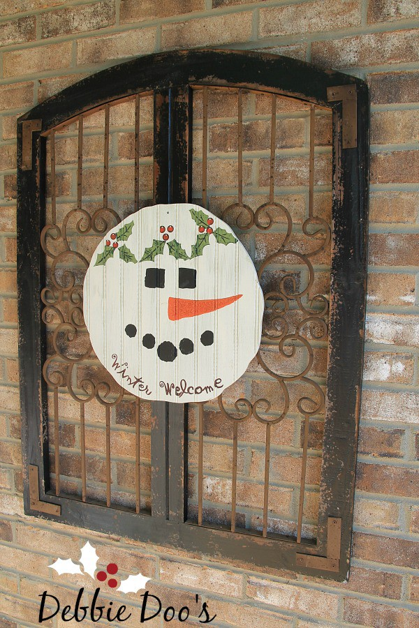 Decorating on the porch for Christmas Snowman pallet sign