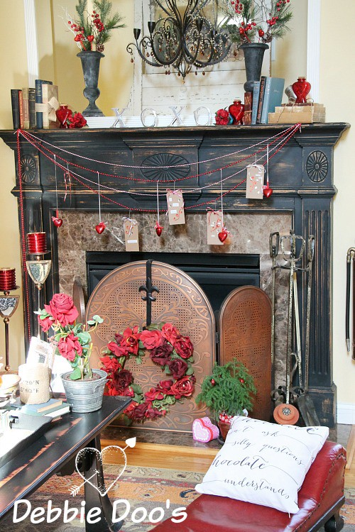 Valentine mantel with diy banner and vintage flair