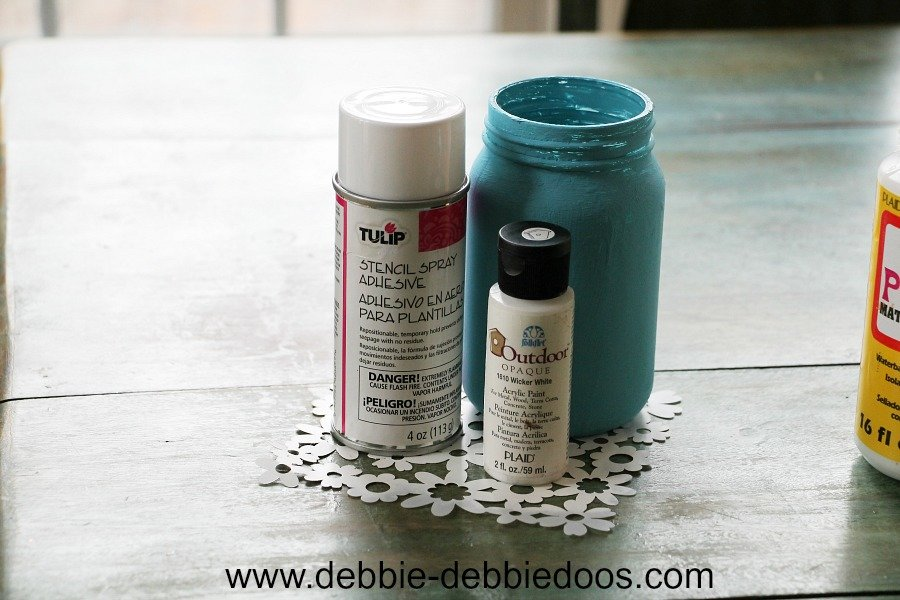 Stencile adhesive and stencil used on a mason jar craft