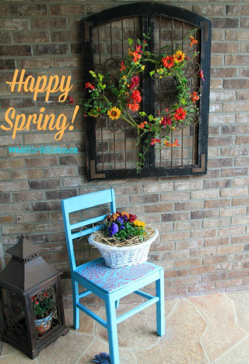 Thrift store chair spray painted and stenciled for Spring porch decor