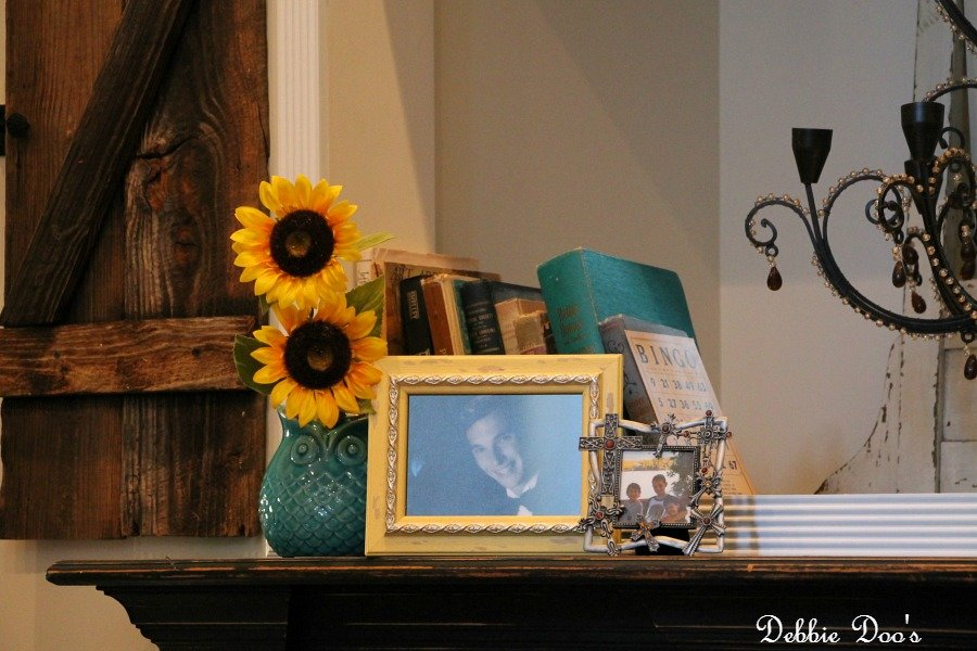 decorating the mantel with photos and old books