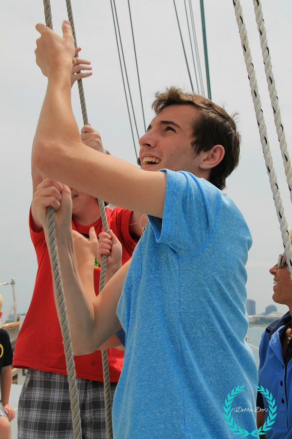 alex hoisting up the sails on the windy sail ship