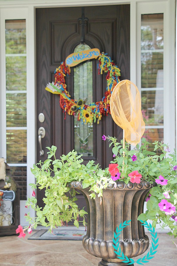 Southern porch with a whimsical twist and a fun wreath idea. Dollar tree decor and more..