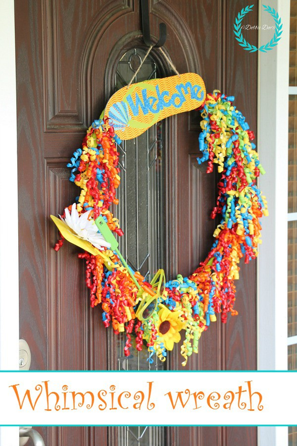 Whimsical wreath idea with dollar tree goods. You can't believe what I used!