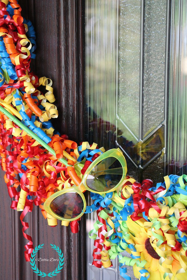 summer wreath made with dollar tree supplies. Gift bow wreath idea