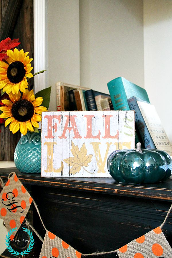 Fall mantel with sunflowers and owls