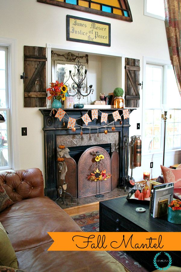 fall mantel decor with owls and sunflowers