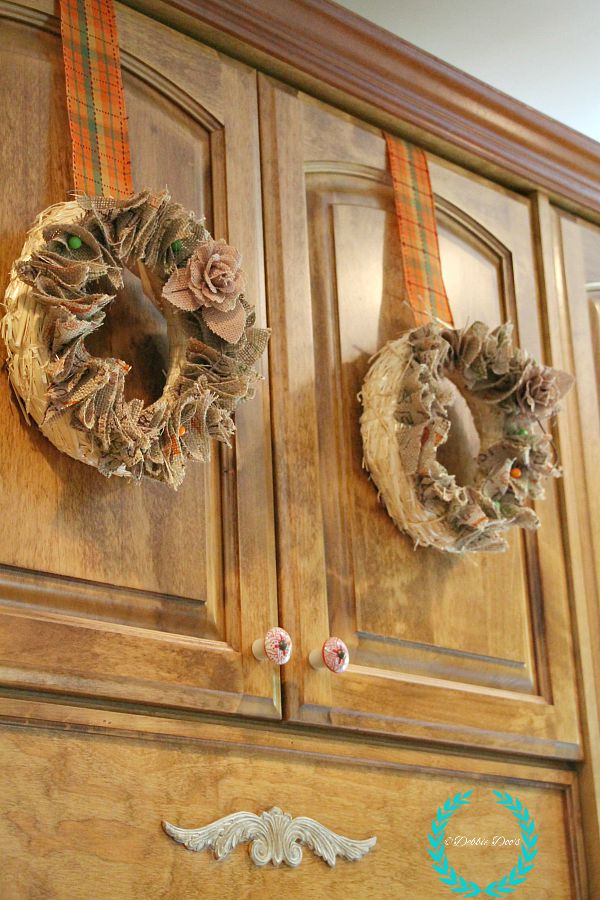 mini cabinet wreaths for fall decor in the kitchen