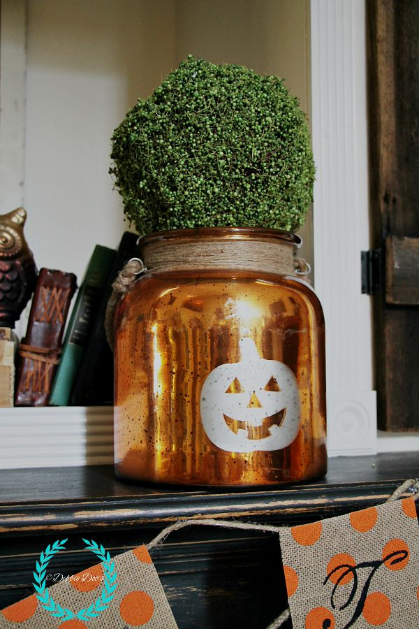 pumpkin vase on fall mantel from Home goods