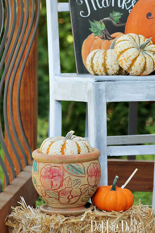 Decorating with pumpkins and gourds outdoors