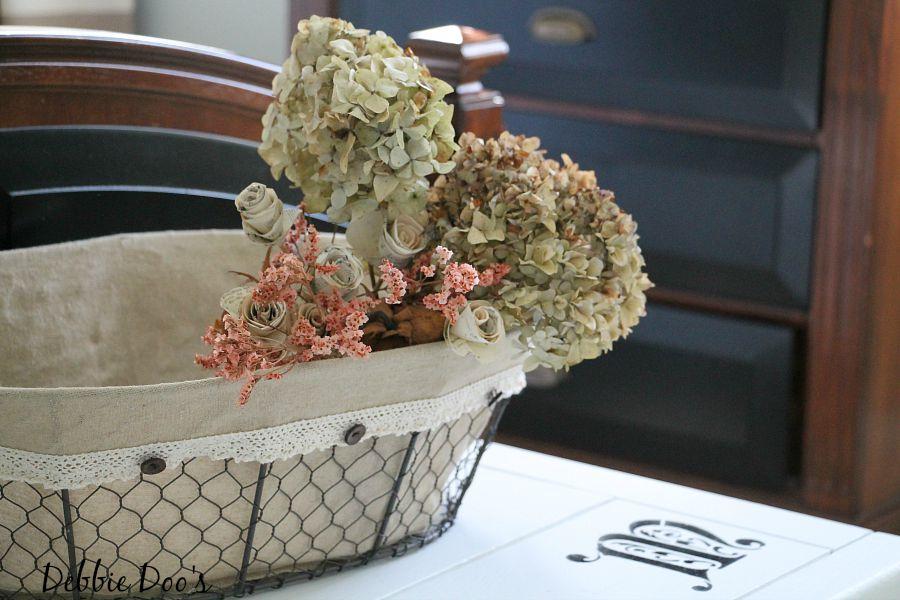 dried hydrangeas in a burlap basket