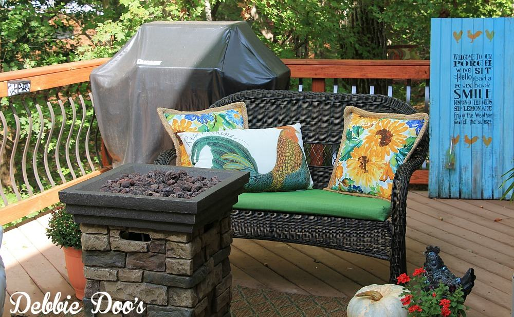 decorating an outdoor bench for the fall season
