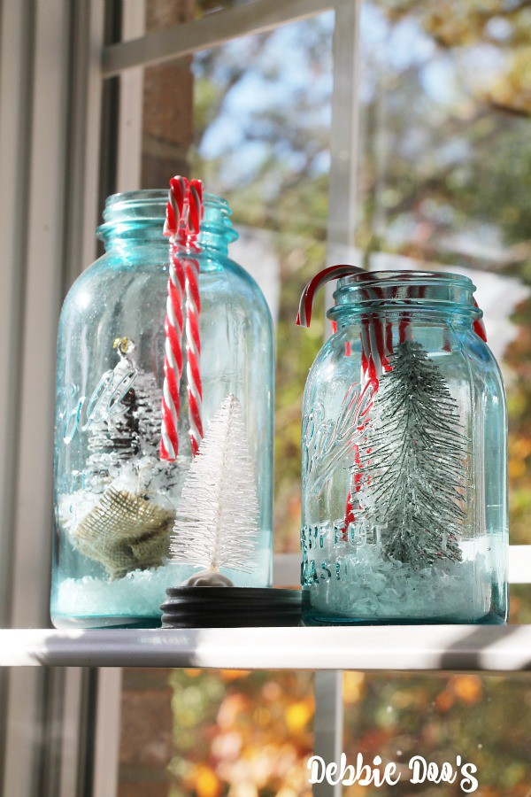 Blue ball mason jars filled with Christmas trees