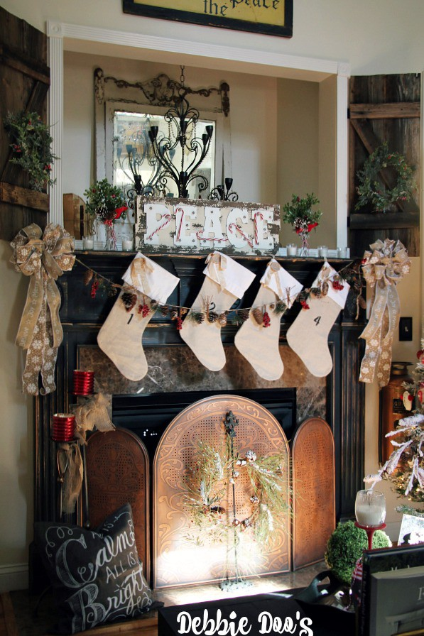 Rustic elegant Christmas mantel with burlap stockings and Peace marquee sign