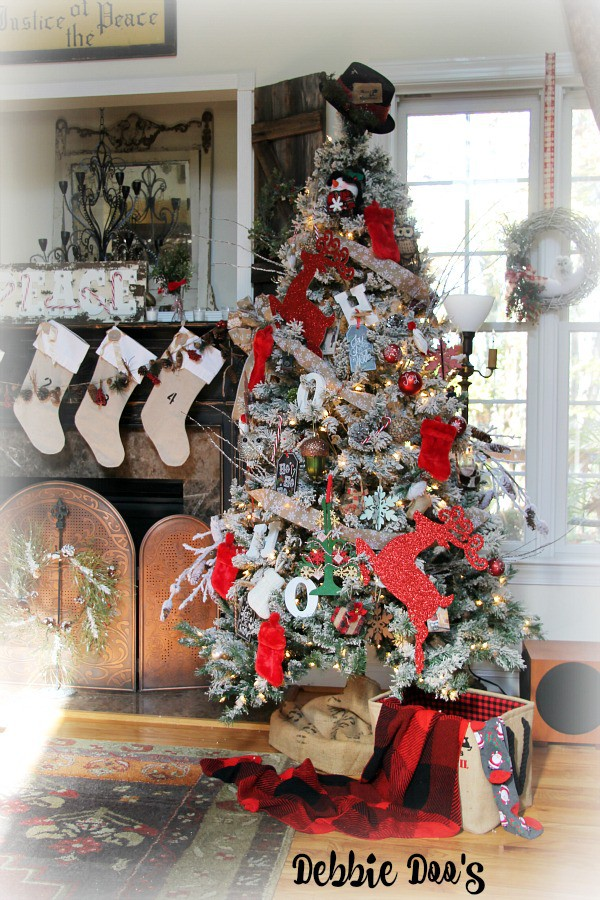 Flocked Christmas tree decorated with traditional colors and whimsy