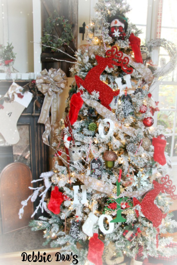 Ho ho ho Merry Christmas festive flocked tree with reds and white and burlap garland