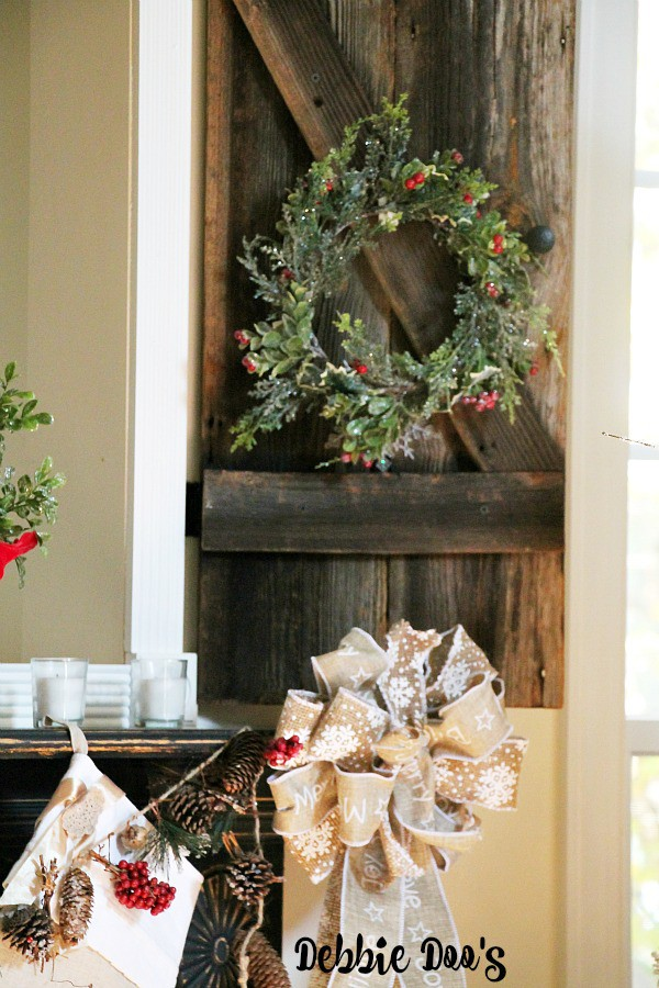 Rustic wood shutters that anchor the fireplace surround