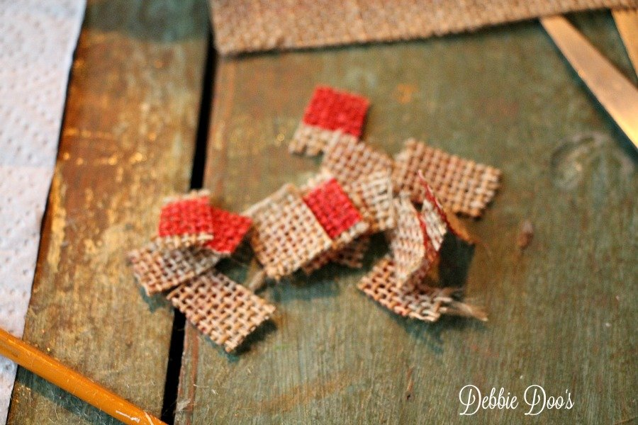 cut up pieces of burlap for glass ornaments